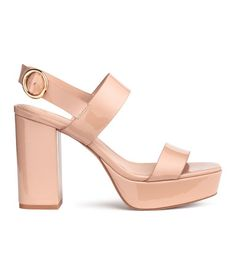 Powder beige. Platform sandals in faux patent leather. Adjustable strap at heel with metal buckle. Faux leather lining and insoles. Rubber soles. Front