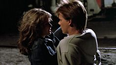 http://www.hotflick.net/flicks/1984_Footloose/big/fhd984FLE_Lori_Singer_017.jpg  Footloose (1984) Lori Singer (Ariel Moore) and Ren McCormack (Kevin Bacon) in the abandoned warehouse where he aspires to have the prom. Ariel is a risk-taker and in an abusive relationship with her boyfriend, Chuck Cranston (Jim Youngs).