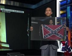 CNN's Don Lemon went on air and held up a Confederate flag and a sign with the N-word on it and asked if viewers were offended. But he didn't stop there.