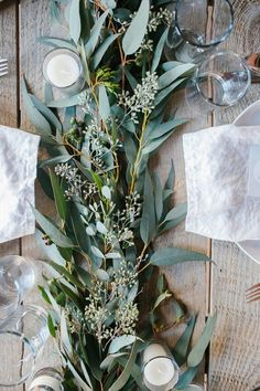Table centerpiece with seeded eucalyptus and candles