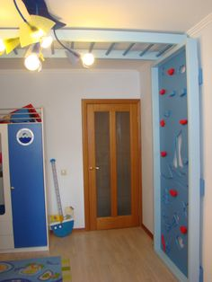 Home gym! Climbing wall and monkey bars take hardly any space. I would do this in my boys bedroom!