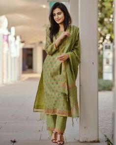 Shop online Pistachio green kurta with straight pants and dupatta This pistachio green block printed chanderi kurta is a must have for your wardrobe. It includes block printed straight pants and a dupatta which completes the look. Indian Fashion Dresses, Dress Indian Style, Indian Outfits, Indian Attire, Indian Wear, Kurtha Designs, Dress Designs, Kurta With Pants, Kurti Patterns