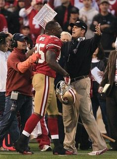 **Best game EVER!**  San Francisco 49ers tight end Vernon Davis (85) is greeted by head coach Jim Harbaugh after scoring on a 14-yard touchdown reception against the New Orleans Saints during the fourth quarter of an NFL divisional playoff football game Saturday, Jan. 14, 2012, in San Francisco. The 49ers won 36-32. (AP Photo/Jeff Chiu)