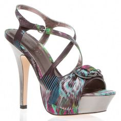 A buckle accent over the toe adds panache, as does ikat-print fabric.