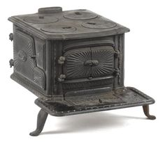 Southard Robertson Co. cast iron Little Eva toy stove, 8 3/4'' h., 10 1/2'' w.