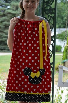 Adorable! Minnie Mouse Pillowcase dress or Top, Inspired by one of our favorites. The Mickey head is a pocket and the bow has a safety pin for easy washing. All dresses come with Ponytail Streamers or a Hair Bow in matching ribbon. All dresses are double hemmed with french seams so no raw edges. Fabric is Pre-Washed and smoke free. 3 mo. measures 11 long 6 mo. measures 13 long 12 mo. is 15 long 18-24 mo. is 17 long 2T is 19 long 3T is 21 long 4T is 23 long 5 is 25 long 6 is 27 long...