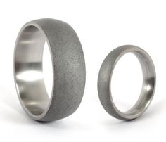 These rings are made of dark sandblasted titanium. Hand-made, with special care, resulting in unique pieces. Titanium is a very lightweight material.