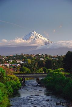 New Plymouth, New Zealand. I've been there twice, on that very bridge, but never see the mountain due to the weather