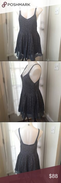 FREE PEOPLE Smocked Floral Dusty Blue Purple Dress Brand New❣️ Super sweet and feminine with that signature boho vibe. Features hidden side zipper, stretch smocked front bust, airy hem and overall cotton slip styling. Women's Size 12 ❤️ Free People Dresses Mini