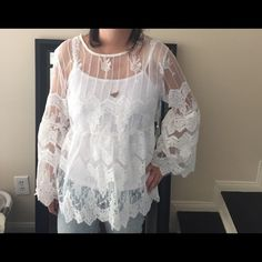 Boho lace bell sleeve top Beautiful lace detailing. Size says Large but fits more like a small so marked accordingly. Received as a gift but lace is stiffer than I would like. Comes with inner tank. Tops Blouses