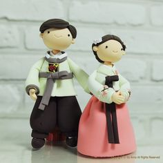 Hey, I found this really awesome Etsy listing at http://www.etsy.com/listing/70343828/korean-hanbok-custom-wedding-cake-topper