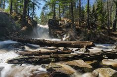 A spring view of Black River Falls flowing on a sunny day. Ishpeming, MI