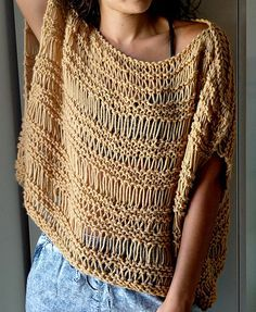 This is a free knitting pattern available on my blog at TheSnugglery.net. It uses big needles and worsted weight yarn and works up super quick. It's a fun, lacy, warm weather pattern that makes a boxy top. You can always add more rows for a beach cover-up or less for a cute crop top. Either way, I'd love for you to check it out and share your projects here on Ravelry!