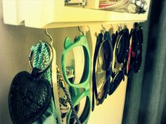 Put hooks under bedroom or bathroom  mirror to store jewelry, etc..* I did this a while ago on a shelf to store sunglasses and I LOVE this