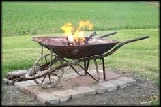wheelbarrow fire pit - (put sand in bottom of barrow)