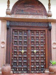 Carved door of the Ismaili Jamatkhana (Aga Khan Mosque) in the Gujarati style in Stone Town (Zanzibar)