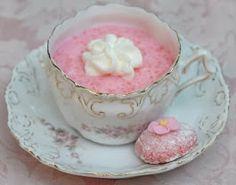 Pink tapioca pudding and pink amaretti cookie