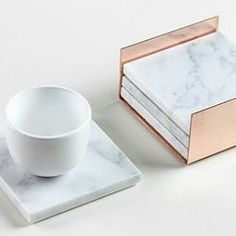 The coasters are made of solid Carrara marble and measures square., The coasters are made of solid Carrara marble and measures square. There are four protective felt pads at the bottom of the marble. Marble Tray, Carrara Marble, Home Decor Accessories, Decorative Accessories, Copper And Marble, Diy Home Decor, Room Decor, Home Decor Items, Decor Scandinavian