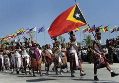 Celebrations . . . Traditional East Timorese tribal warriors take part in the official procession to mark the country's 10th anniversary of independence.