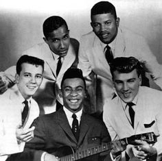 "The Marcels were a doo-wop group. The group formed in 1959 in Pittsburgh, with lead Cornelius Harp, bass Fred Johnson, Gene Bricker, Ron Mundy, and Richard Knauss. In 1961 many were surprised to hear a new version of the ballad ""Blue Moon"", that began with the bass singer saying, ""bomp-baba-bomp"" and ""dip-da-dip."" The record sold over one million copies, and was awarded a gold disc."