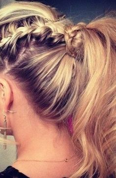 Ponytail with a Twist: With summer temperatures reaching record highs, there's no better way to combine style and function like a sweet little ponytail with an edgy twist.