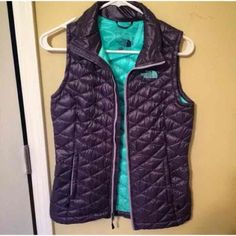 NWOT North Face Vest New, no damages. Only selling because it's too small. Size XS. Pretty plum color with blue inside and logo. Cheaper on ♏️erc North Face Jackets & Coats Vests