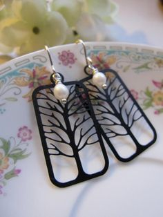 Hey, I found this really awesome Etsy listing at https://www.etsy.com/listing/93171689/black-tree-earrings-lazer-cut-filigree