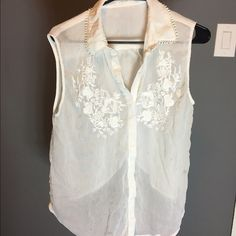 Beautiful white blouse w/flower design Beautiful white blouse w/flower design it's a high low blouse. With the low part being on the back part of shirt and back also has a cute slit. This blouse is perfect for summer Lush Tops Button Down Shirts