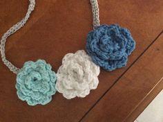 Frozen inspired headband $15.00. Silver headband with three roses. 100 percent cotton