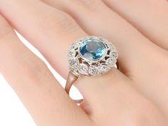 Blue Notes of a Zircon Diamond Halo Ring - The Three Graces