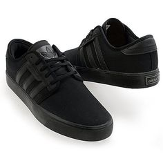 All black Seeley Adidas.
