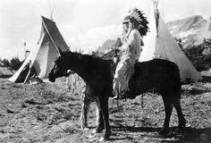 Eneas Paul Koostatah, a Kootenai Indian, poses on his horse at Logan