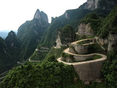 Tianmen Mountain: Heaven Linking Avenue has 99 turns. It is famed as the number one road in the world. Covering a distance of 10.77 km, it zigzags its way from 200 meters to 1300 meters above sea level, flanked by precipitous cliffs and deep valleys. The posture of the mountain is like a soaring great dragon. It has 99 turns symbolizing the Heaven has nine palaces.