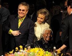 Lily Safra con Elton John y Nelson Mandela.