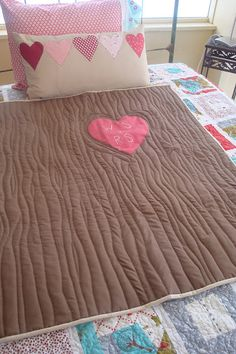"""Quilted Tree with heart and initials """"carved"""" into it. This is a darling wedding quilt or engagement gift for the bride to be."""