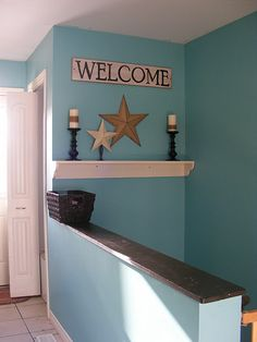 Great idea for where my basement stairs are..almost identical with the 1/2 wall...