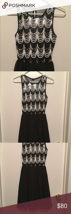 Formal prom/wedding type dress with sequins Beautiful gorgeous formal dress with white silver and black flowy material with mesh top. Only worn once for a graduation. In pristine condition & fits true to size 1 (Juniors) or can fit size XS/0/00 As U Wish Dresses Prom