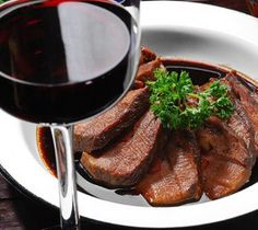 Slow cooker beef steak in wine sauce.Beef steak with vegetables and Burgundy wine cooked in slow cooker.