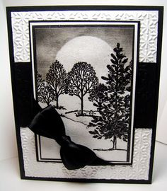 card creates a moonlit night scene in black and white with a luxurious black bow...