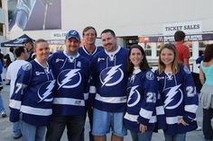 Group of season ticket members in their Tampa Bay blue jerseys.