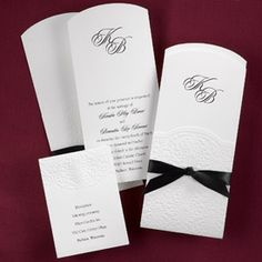 """Hi-White Invitation with Short-Fold Jacket  Your hi-white non-folding invitation is secured to its coordinating jacket with satin ribbon. Detailed embossing covers the jacket's short-fold front, which stops just below your selection of monogram. Your choice of black, lavendar, pink, red or white satin ribbon. Customer assembly required.  Enclosures 3 1/2"""" wide x 4 7/8"""" folded."""