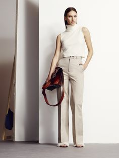 High-waisted suit trousers and a ribbed polo cuts a sleek silhouette