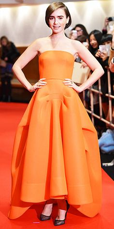 It's hard to take the attention away from a bright orange gown with a full skirt (not to mention Lily's signature bold brows, but we can't stop looking at her cool, translucent heels at the Tokyo premiere of Love, Rosie.