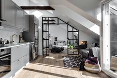 [Room] Small attic apartment in Stockholm, Sweden uses an industrial glass wall to partition the bedroom from the rest of the space. Attic Bedroom Small, Attic Rooms, Attic Spaces, Small Rooms, Small Spaces, Attic House, Attic Bathroom, Tiny House, Attic Renovation