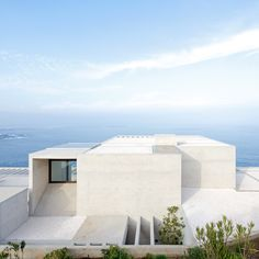 This coastal home in Chile by architect Gonzalo Mardones Viviani is set down into a cliff so as not to disrupt sea views from the road running alongside.