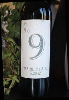 I love this - a wine bottle with your table number. (you can personalize it and put the couple's name on it too) <3