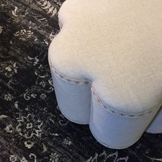 No vase needed for this unique Norwalk ottoman, but if you're on the hunt for one, we've got plenty to choose from! {Down To Earth}  #downtoearthhome #gardnervillage #norwalk #norwalkfurniture #ottoman #furniture #home #interiordesign #interiors #floral #designlovesdetai
