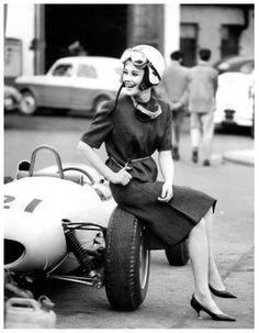 Vintage racing car and girl driver