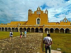 IZAMAL YUCATAN MEXICO FAMOUS CONVENT SAN ANTONIO DE PADUA FACADE - THIS CONVENT WAS BUILT ON TOP OF THE FOUNDATION OF A MAYAN PYRAMID - THE SPANISH FORCED THE MAYAN INDIANS TO DISMANTLE THE PYRAMID TO BUILD THEIR CATHOLIC CHURCH