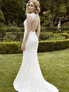 2016 Enzoani 'Inverness' - www.yourdreambrid... | A walk down the aisle will never be more stunning: this full-length mermaid gown featuring an illusion sweetheart neckline, delicate Guipure lace over stretch lace, and keyhole back with pearl buttons elegantly extending down the length of the train is sure to turn heads coming and going.